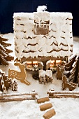Gingerbread house with atmospheric lighting,  animal figures
