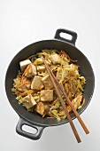Tofu with vegetables in wok (overhead view)
