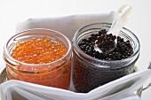 Black caviar and Keta caviar in jars