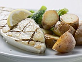 Grilled cod steak with potatoes
