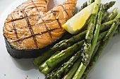 Grilled salmon cutlet with green asparagus