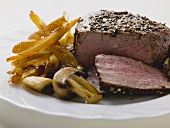 Peppered steak with chips and mushrooms