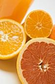 Glass of orange juice, grapefruit and oranges