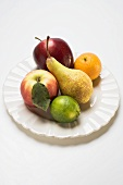 Core fruit and citrus fruit on white plate