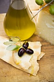 Olives, crackers, olive oil and Parmesan