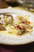 Fish carpaccio with pomegranate seeds