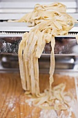 Home-made ribbon pasta on pasta maker