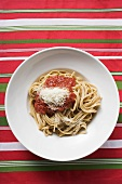 Home-made ribbon pasta with tomato sauce and Parmesan