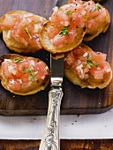 Bruschetta on chopping board