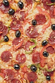 Pepperoni pizza with peppers and olives (full-frame)