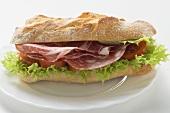 Sausage, tomato and lettuce sandwich