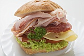 Bread roll filled with ham, salami and cheese