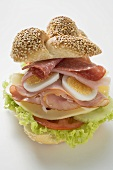 Sesame plait filled with salami, egg, ham and cheese
