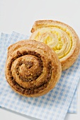 Two coiled buns on checked napkin