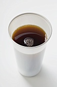 Black coffee in plastic cup