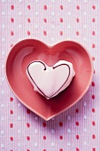 Pink heart-shaped petit four in pink heart-shaped dish