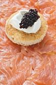 Smoked salmon with toast, crème fraîche and caviar