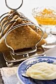 Toast in toast rack, butter, orange marmalade