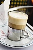 Latte macchiato on table in café