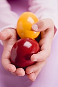 Child's hands holding two Easter eggs