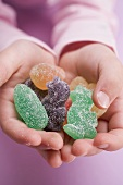 Child's hands holding jelly Easter sweets