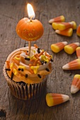 Cupcake with pumpkin candle & candy corn for Halloween (USA)