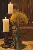 Autumn decorations: candles and cereal sheaf