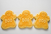 Three orange ghost biscuits for Halloween