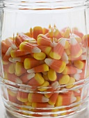 Candy corn (Halloween sweets, USA) in storage jar