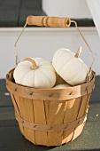 White squashes in woodchip basket