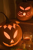 Pumpkin lanterns, cupcake and drink for Halloween