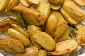 Rosemary potatoes on aluminium foil