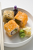 Inside-out rolls with soy sauce, ginger and wasabi