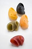 Coloured lumaconi (pasta shells) from above