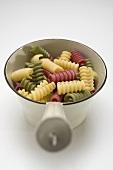 Coloured riccioli in strainer