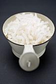 Whole grain corn fusilli in strainer