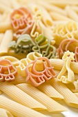 Coloured animal-shaped pasta and penne