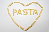 The word 'Pasta' (wagon wheel pasta) in a heart (penne)
