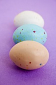 Three speckled Easter eggs