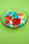 Coloured sugar eggs in glass dish