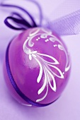 Painted purple Easter egg to hang up