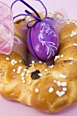 Plaited bread ring with purple Easter egg to hang up (detail)