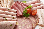 Cold cuts platter with cherry tomatoes and parsley