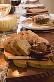 Bread and spread on table laid for Thanksgiving (USA)