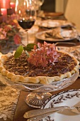 Pecan pie on table laid for Thanksgiving (USA)