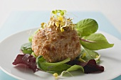 Meat patty with sprouts on salad leaves