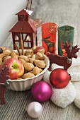 Christmas decoration with apple, nuts, lantern, mittens
