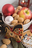 Gingerbread tree ornaments, almonds, apple, Christmas baubles