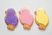 Three Easter biscuits (purple, pink, yellow chicks)