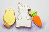 Three different Easter biscuits (chick, Easter Bunny, carrot)